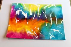 Using bleeding tissue paper and water to make super cool art paper. Good project for kids!