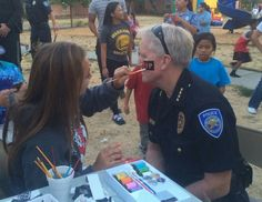 National Night Out Tonight is tonight. Pictured, West Sacramento Police Chief Tom MacDonald, always a good sport,  being facepainted during last year's event.
