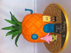 Who lives in a pineapple under the sea? Spongebob and Patrick sugar models with a pineapple shaped cake