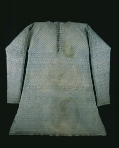 Waistcoat A rare survival of a high quality mid-seventeenth century vest or 'waistcoat' knitted of fine, pale blue-green or 'watchet' coloured silk, said to have been worn by Charles I at his execution by beheading on January 30th, 1649. It is shaped like a long sleeve vest and has a short buttoned neck opening and small upstanding collar. This kind of garment was presumably worn for warmth over a fine linen shirt and underneath a doublet.