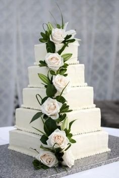 """My first wedding cake!   - This is my first wedding cake and it served 250 people.  It was 5 tiers (14"""", 12"""", 10"""", 8"""", 6""""),  each tier with 3 layers of cake and 2 layers of filling.  The filling was homemade raspberry jam and cheesecake Italian buttercream.  The BC on the outside is a simpler American style BC. by Maria Daici Baptista"""