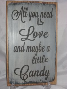 Rustic Wedding Sign All you need is Love and maybe a little Candy Distressed & Antiqued. $19.95, via Etsy.