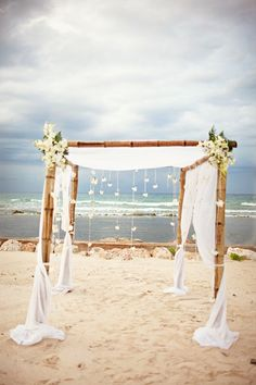 White Fabric Arbor For Ceremony