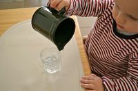 Teaching children to drink from a glass and pour their own water - 12- 18 months