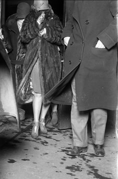 The wife of Peter Gusenberg leaves the morgue after identifying her husband's body. Peter had been one of seven men killed at the garage at 2122 North Clark Street during 1929's St. Valentine's Day Massacre.