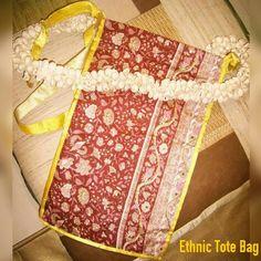 TITLE : Gajra Bag. MEDIUM : Glitter on Cloth. #MeghnaCreations #creations #ethnictotebag #gajrabag #glitter #on #maroon #silk #whitebuds #stitchedup #form #asmart #slingbag #swauve #wear #craftedbyhand #exclusively #customized #madetoorder #traditionally #veryindian #gift #gifting #mumbai #pintrest