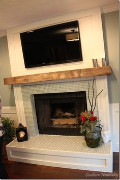 I love the glass tile around fireplace and the wood casing! The Lettered Cottage TV pilot show | Southern Hospitality