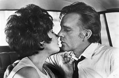 THE COMEDIANS (1963) - Married diplomat's wife (Elizabeth Taylor) has an affair with a hotel owner  (Richard Burton) in revolution-torn Haiti - Based on novel by Grahame Greene - Directed by - MGM - Publicity Still.