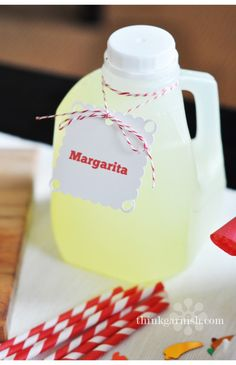 Genius~use old milk jugs for pre made drinks at your next party!!
