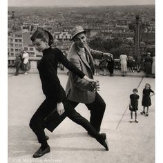 "Audrey Hepburn works with Stanley Donen, the director of ""Funny Face,"" to learn a phrase that shell eventually perform with Fred Astaire in the film. Photo from the Dance Magazine Archives."