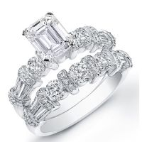 Consider this engagement set as your symbol of eternal love. This gorgeous set features a dazzling Emerald cut diamond with a weight of 1.22 carats as its centerpiece. This diamond has a clarity of VVS2 with a color grade of H. Side round and baguette cut diamonds on the engagement ring and the custom made wedding band enhances the design of this ring. The side diamonds on both rings total 1.98 carats. These diamonds are VVS2 in clarity and G-H in color. The clean lines of this set is…