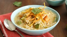 White Bean Chicken Chili Recipe Main Dishes with boneless skinless chicken breasts, olive oil, onions, ground cumin, water, no salt added cannellini beans, chop green chilies, undrain, Knorr® Rice Sides™ - Herb & Butter, medium zucchini