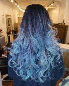 There are many shades of many colors in this look, all done in the balayage, free-hand style. You can see silvers and grey, lilac and purples, bright blues and baby blues.