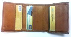 Le portefeuille en cuir marron de Jean