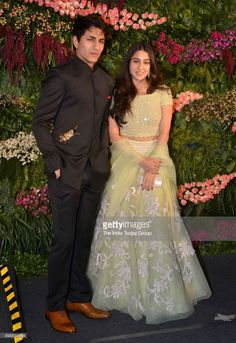 Sara Ali Khan and Ibrahim at Virat Kohli and Anushka Sharmas reception in Mumbai. Engagement Dress For Groom, Engagement Dresses, Indian Wedding Gowns, Indian Bridal Fashion, Wedding Dress, Bollywood Celebrities, Bollywood Fashion, Bollywood Dress, Pakistani Dresses