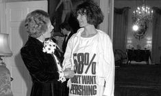 Margaret Thatcher greets Katharine Hamnett, wearing a T-shirt with a nuclear missile protest message, at 10 Downing Street, where she hosted a reception for London Fashion Week designers in Katharine Hamnett, Suzy, Political Slogans, Famous Slogans, Silk T Shirt, Vogue, Chanel, Fashion Brand, Fashion Design