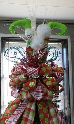 Check out this item in my Etsy shop https://www.etsy.com/listing/256417182/elf-legs-christmas-tree-topper-ready-to