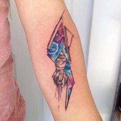 Galactic rocket tattoo on the left forearm. Tattoo artist:...