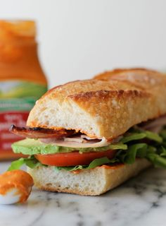 Avocado Club Sandwich with Spicy Chipotle Pepper Spread - A turkey-bacon club sandwich amped up with fresh avocado slices!