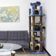 Space-saving tall narrow jungle cat tree with leaves that can be shared by several cats while hosting all their desired feline activities. Jungle Cat, Cat Towers, Tree Leaves, Cat Tree, Space Saving, Ladder Decor, Kitty, Babies, Babys