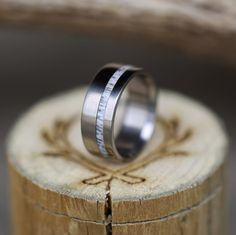 Handcrafted wedding band made from elk antler inlay.