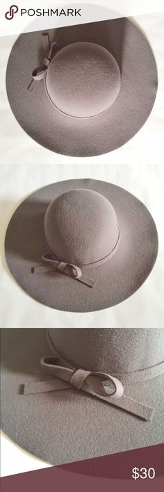 Felted Floppy Hat in Dove Gray This hat has a beautiful gray color that can coordinate with countless outfits in your closet! The bow accent adds a touch of femininity to a classic accessory. This hat has never been worn but does not have its original price tag. I highly recommend this hat to elevate your closet! Rue 21 Accessories Hats