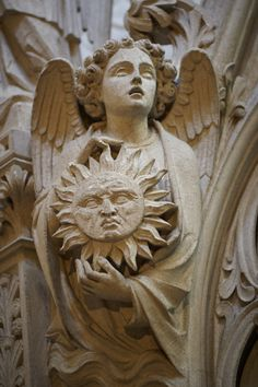 Winchester Cathedral angel with sun by Robert Mealing