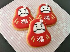 Daruma cookies. Daruma are traditional Japanese dolls. They're usually sold with blank eyes. You fill in one eye when you set a goal, and the other when you achieve it. They're a symbol of perseverence and good luck.