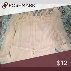 Ivory blouse Long sleeve with lace on top. I believe it's a medium but runs big so fits a large Tops Blouses