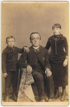 post-mortem photography: looks as though they are holding up their dead older brother