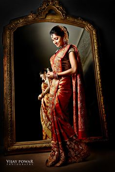 South Indian bride. Temple jewelry. Jhumkis.Red silk kanchipuram sari.Braid with fresh jasmine flowers. Tamil bride. Telugu bride. Kannada bride. Hindu bride. Malayalee bride.Kerala bride.South Indian wedding Picture Courtesy : Vijay Powar Photography