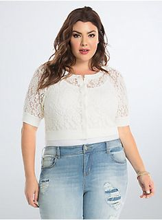"""<p>A romantic topper to any outfit, this ivory lace shrug is ideal for sweetening up your look (and keeping that nip in the air in check). The stretchy ribbed knit trim lends definition to the cropped cut, a button front keeps the sheer style secure.</p>  <p></p>  <p><b>Model is 5'9"""", size 1</b></p>  <ul> <li>Size 1 measures 21"""" from shoulder</li> <li>Polyester/spandex/rayon/nylon</li> <li>Wash cold, dry flat</li> <li>Imported plus size shrug</li> </ul>"""
