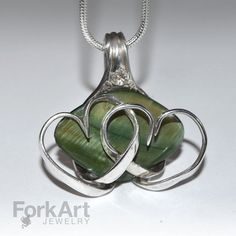 Fork pendant with green shell bead and tines by ForkArtJewelry, $70.00