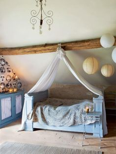 Medievalish children's room, love the hanging lanterns