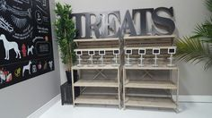 Retail decor for the Fluffy Carnivore. Rustic, barn displays. wood Crate shelving. Pet store. order online.