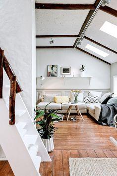 vigas de madera planta abierta panelados de madera pared ladrillo visto estilo rústico estilo nórdico distribución diáfana decoración blanco y madera decoración áticos y dúplex