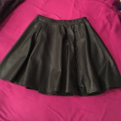 Black leather with studs skirt Black leather skirt with studs, only worn once, great condition! Wallflower Skirts Mini