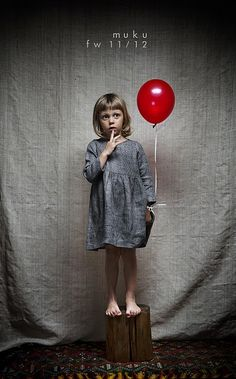 Love the idea of the red balloon against the grey for a photo