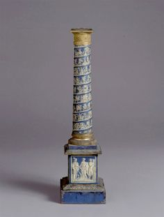 An exquisite & very delicate 17 century italian candlestick-obelisk type in the shape of a trajan column with gorgeous blue & white details.
