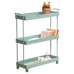 "Blue metal cart.  Product: CartConstruction Material: MetalColor: Distressed blueFeatures:  Three tier Casters Dimensions: 35.7"" H x 32.29"" W x 10.6"" D  Note: Accents pictured are not included"