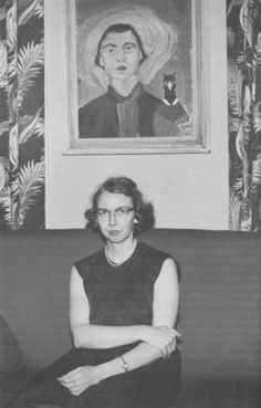 Flannery O'Connor sitting beneath a self-portrait