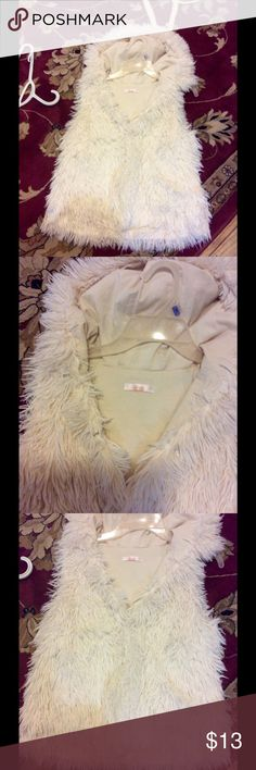 Kaitlin hooded vest Really cute I think I bought it off here but to small for me it's cream color really soft cute I wish it did fit ones it has a hood Kaitlen Jackets & Coats Vests
