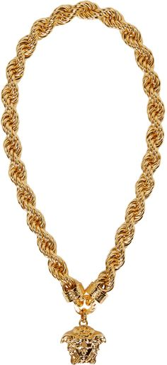 Thick rope chain in glossy gold-tone.  Signature Medusa head logo pendant. Greek key trim detailing at front. Approx. 28