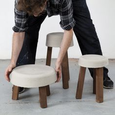Make a 3-legged stool with simple materials like concrete and wood scraps to achieve chic DIY seating.data-pin-do=
