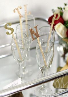 glitter letter drink markers... so cute! --- Find Gold glittered chipboard letters at Michaels