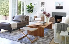simple, pretty furniture arrangement with daybed and campaign stool