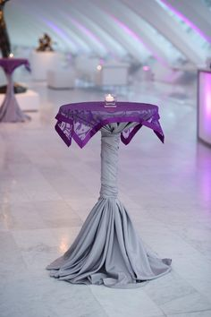 Do this in the back in colored linen that matches the accent linen on the main tables (the main tables have ivory). Remove the short top piece b/c it looks weird