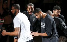Spurs' LaMarcus Aldridge (from left), Kawhi Leonard, Tim Duncan, Tony Parker and Danny Green huddle during introductions before the game with the Cleveland Cavaliers on Jan. 14, 2016 at the AT&T Center. Photo: Edward A. Ornelas /San Antonio Express-News / © 2016 San Antonio Express-News