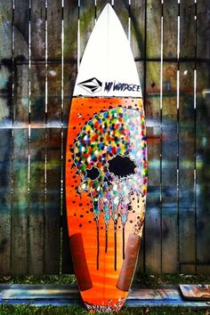 Painting on a surfboard. Surf art