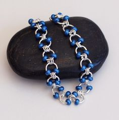 Metallic Blue Beaded Chainmaille Bracelet, Cable Weave Chainmaille Bracelet, Chain Mail Jewelry, Chainmaille Bracelet, Beaded Chain Mail by PJsPrettys on Etsy https://www.etsy.com/listing/167290627/metallic-blue-beaded-chainmaille